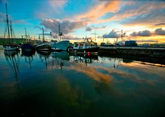 Harbour Sunset (Dave G Kelly) Tags: ireland sunset sea sky irish reflection water clouds port canon boats mirror boat interestingness fishing marine harbour dingle kerry explore 5d canon5d trawler sigma1020mm trawlers cokerry sigma1020 i500 i193 top20ireland colorphotoaward aplusphoto davegkelly