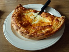 Calzone (Svadilfari) Tags: food cheese restaurant knife newengland newhampshire plate nh pizza calzone extracheese greatnorthwoods villagepizzaandgrill