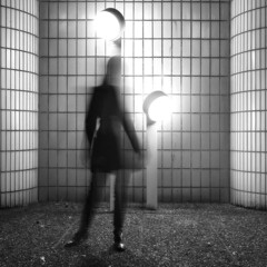 The girl of the night (edouardv66) Tags: longexposure light people bw woman motion girl wall backlight night tile switzerland blackwhite moving movement nikon suisse geneva sigma nb genève noirblanc 2470 nikonsigma d700