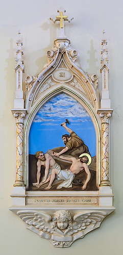 Saint George Roman Catholic Church, in New Baden, Illinois, USA - XIth station of the cross, Jesus is nailed to the cross