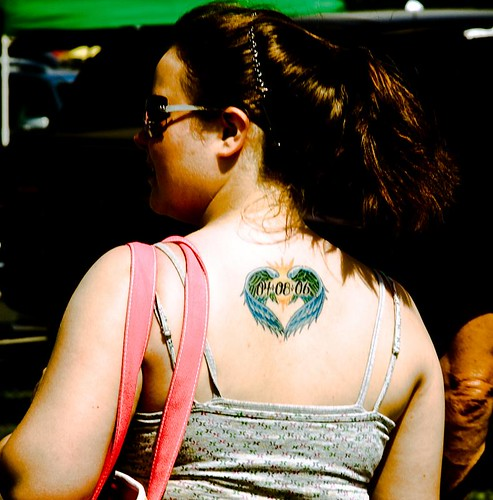 Love Tattoos sexy at Upper Back. Label: natural women tattoos,