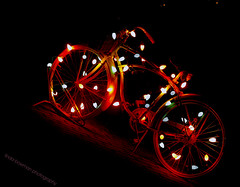 Light bright bike (lynne_b) Tags: christmas holiday bike bicycle night season lights store illinois nightshot wheels decoration christmaslights storefront archives bulbs genevaillinois