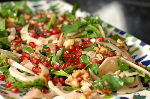 Watercress, fennel, pomegranate, walnut, and cheddar salad