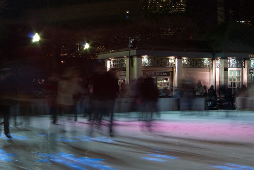 Night time ice skaters