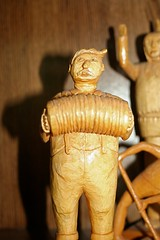 Carving of accordion player
