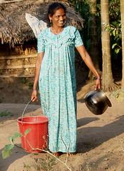 Water carrier (bokage) Tags: woman india water stream village kerala adivasi mannon pariyar
