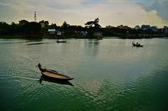 [360/365]: In the land of rivers (A. adnan) Tags: lake green water beautiful project river boat nikon colours bokeh dhaka bangladesh boatmen gulshan project365 365days bangladeshiphotographer peopleofbangladesh gettyimagesbangladeshq2 gettyimageschinaq12012 gettyimagesbangladeshq12012