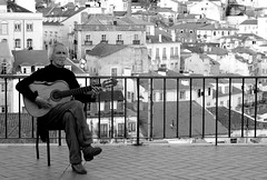 Music is Everywhere (Part III) (Sandra_R) Tags: life old city houses blackandwhite bw music man portugal architecture outdoors exterior guitar decay lisboa lisbon background details santaluzia viewpoint urbanscenes lx ilustrarportugal fredomergner