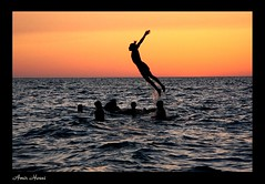 Freedom (amir hosni) Tags: sunset sea sun beach swim fly flying persian jumping shine iran god persia amir swimmer caspian mazandaran khazar khoda hosni abigfave lifebeautiful canoneos40d