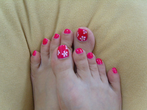 Nice red with white flowers over the nail. A toe nail design for toenails body art.,