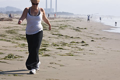 Close-up of female girl exercising by aerobic walking (mikebaird) Tags: beach water girl lady female strand sand chick walker morro aerobics morrostrand striding