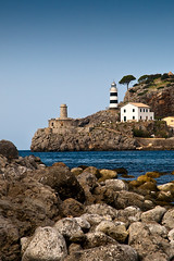 Punta De Sa Creu Lighthouse (Philipp Klinger Photography) Tags: blue sea sky lighthouse tree water rock pine port de faro puerto island islands spain rocks waves espana punta creu sa mallorca philipp baleares soller balearic klinger illes aplusphoto dcdead
