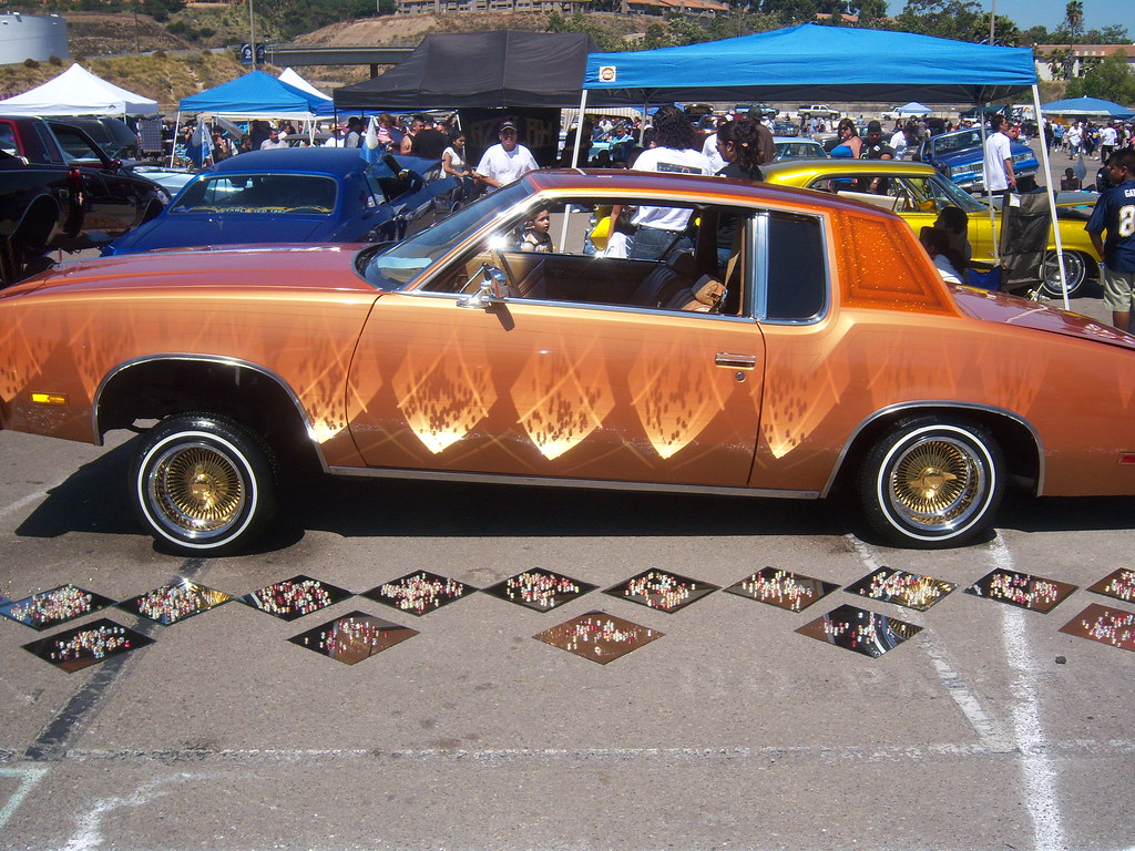 Lowrider cars with girls doubtful