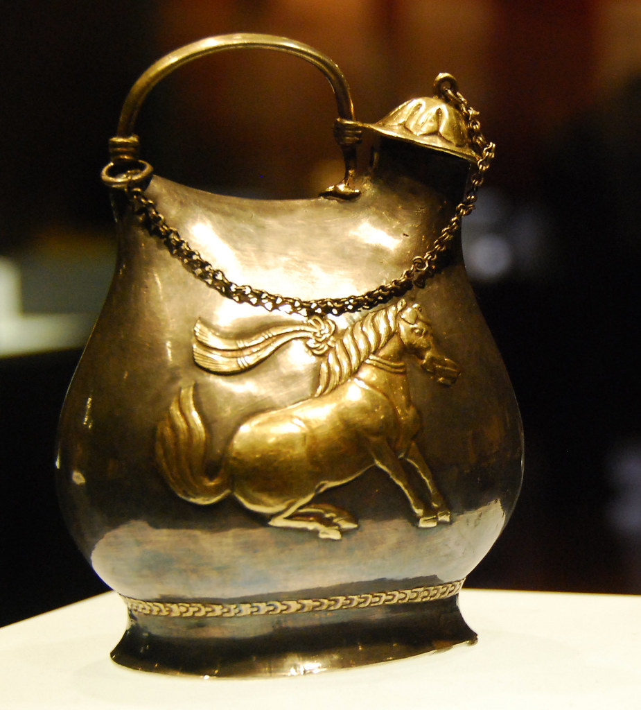 Gilded Silver Flask with Dancing Horses Holding Cups in Their Mouths. Tang Dynasty ????????????