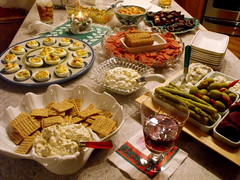 Party time!  :) (**Ms Judi**) Tags: party food ice cheese table spread yummy candle drink chocolate nuts scene delicious stove christmasparty drinks olives napkins eggs plates hungry snacks happyholidays appetizers dip goodies crackers partytime partyfood rumanddietcoke pickledbeets msjudi judistevenson judystevenson