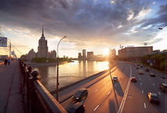 Hotel Ukraine at sunset (Andrey Permitin) Tags: road old bridge light sunset urban cars architecture reflections cityscape moscow sevensisters embankment   hotelukraine          stalinsskyscrapers