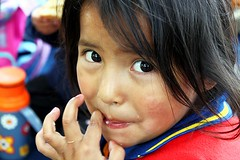 Eating with Hands (Petarine) Tags: latinamerica southamerica girl child bolivia cochabamba bolivianchild boliviangirl indigenouschild indigenousgirl