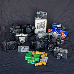 Some of my film cameras (Pezti) Tags: canonae1program polaroid600 kiev88 yashicaelectro35 fed5c canoneos5d agfaisolaii minoltamaxxum7000 yashicaministerd canon1740mm vivitarultrawideandslim