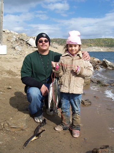 Father and daughter show off the day's catch at Diamond Lake near Hemet, California