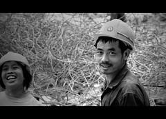 Hard Hats & Soft Smiles (Michael Steverson) Tags: china white black hat canon concrete site steel bricks hard smiles games demolition gloves crew rebar straighten rubble allrightsreserved tangled guangxi expatriate liuzhou construcion 40d expatriategames