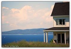 dreams (suesue2) Tags: sky house lake sunshine clouds michigan lakemichigan upnorth lastsummer suesue2 bayharborresort amazingmich golfingwithmybrotherandhiswife aviewfromoneoftheholescantrememberwhichone