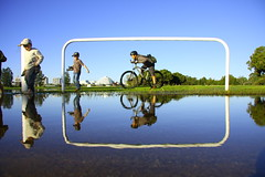 crop suggestion (maybemaq) Tags: blue sky reflection water bike bicycle kids children puddle child mountainbike saturday sunny australia symmetry perth frame reflexions aftertherain trap breathtaking cropsuggestion eyewashdesign maybemaq aplusphoto