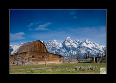 Mormon Row (Aaron Price Design & Photography) Tags: morning sky snow mountains nature barn fence landscape wyoming grandtetons peaks polarizer mormonrow aaronprice