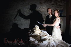 Olivier & Ann-Elise Wedding: cutting (stabbing) the cake by beautifoto
