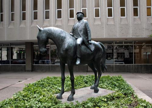 Businessman on a Horse - by William McElcheran