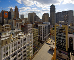 merchant's row (gsgeorge) Tags: city urban skyline downtown detroit metropolis woodward verticality centralbusinessdistrict booktower downtowndetroit woodwardavenue canonefs1022mm efs1022mm penobscotbuilding detroitskyline woodwardave perspectivecorrected merchantsrow davidstott