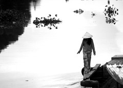 River Beauty (DufferLong) Tags: blackandwhite bw white black water girl beautiful river asian boat blackwhite asia southeastasia long pretty vietnamese gorgeous vietnam explore graceful nguyen duffer nonla interestingness416 i500 canonef135mmf2lusm longnguyen canoneos40d earthasia dufferlong