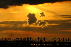 Singapore Sunset (Life in AsiaNZ) Tags: light sunset man clouds golden singapore cranes pollution oil environment refineries flickrgiants