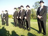 green groomsmen style black groomsmen style green tuxedo black tuxedo wedding photo