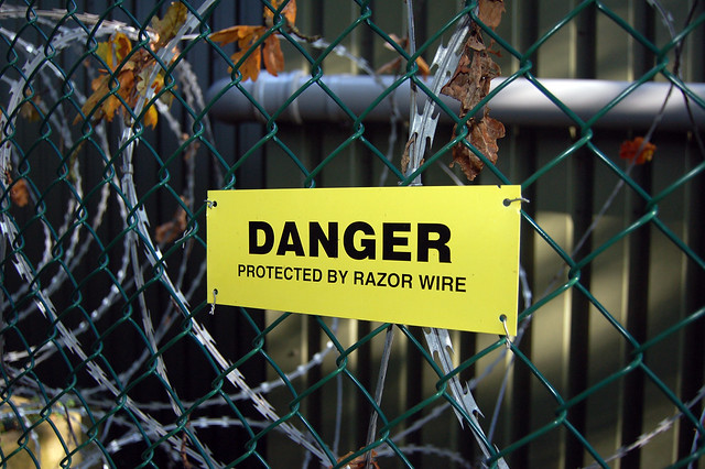 Danger - Protected By Razor Wire