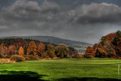 (Timsalabimm) Tags: autumn nature field grass clouds forest canon dark herbst natur feld wiese wolken 2008 wald darkclouds dunkel friedrichshafen tonemapped lightzone dunklewolken
