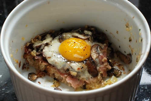 Baked eggs with cheddar, ham, and sauteed cremini mushrooms