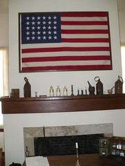 30-star flag over sick bay mantle