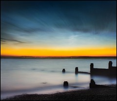Nature in motion (adrians_art) Tags: longexposure morning blue sky cloud beach yellow reflections dawn coast early waves tide earlymorning shore northsea groynes