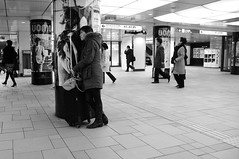 we all need somebody to lean on (jonathan_pui) Tags: street blackandwhite nikon streetphotography d300 omotensando weallneedsomebodytoleanon leaningonapole leaningonsomeonesback insideatrainstation peopleandtheirenvironments