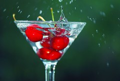 cherry bomb ! (*Peanut (Lauren)) Tags: red green cherry cherries searchthebest bokeh flash martini fastshutter shutterpriority hbw bokehwednesday