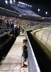 young NASCAR fan (haglundc) Tags: boy car racecar fence fan kentucky young chainlink nascar 300 oreo meijer stands speedway photolink