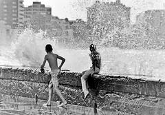 Waves on the Malecon (jendayee) Tags: travel kids town blackwhite waves noiretblanc havana cuba malecon blackwhitephotos goldstaraward