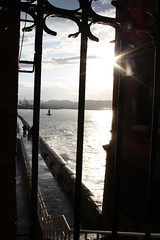 rompeolas enrrejado (Ana M. O.) Tags: sea sky clouds faro mar gijón asturias escalera cielo nubes reflejo gijon olas barandilla verja