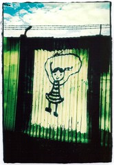 rope skipping girl with barbed wire (Aliceblueblazes) Tags: streetart xpro crossprocessed whimsy sydney lomolca gentrification newtown feh disappearingnewtown
