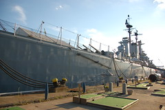 USS Salem park: stern of the cruiser, plus mini golf putt-putt course & Nazi German mini submarine (Chris Devers) Tags: ocean bridge sea water museum architecture river golf ma quincy boat ship unitedstates massachusetts sub nazi ironcross navy vessel mini minigolf submarine puttputt german maritime vehicle drawbridge uboat salem nautical naval 2008 usnavy weymouth cruiser uss warship coldwar puttputtgolf liftbridge shipbuilding quincyma foreriver usssalem heavycruiser foreriverbridge ca139 cameranikond50 forerivershipyard weymouthma exif:flash=flashdidnotfire exif:exposure=0001sec11000 exif:iso_speed=200 exif:focal_length=18mm exif:aperture=f35 unitedstatesnavalshipbuildingmuseum exif:exposure_bias=06ev camera:make=nikoncorporation camera:model=nikond50 meta:exif=1257954901 exif:orientation=horizontalnormal exif:filename=dscjpg meta:exif=1350405607