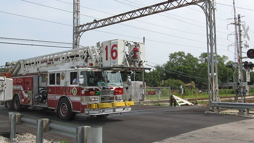 Southbound Skokie Fire Department ariel ladder truck crossing the CTA Yellow line at Kostner Avenue. Skokie Illinois. August 2008. by Eddie from Chicago
