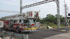 Southbound Skokie Fire Department ariel ladder truck crossing the CTA Yellow line at Kostner Avenue. Skokie Illinois. August 2008.