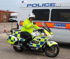 Police Bike next to Met Style Van
