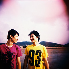 our smile  (Karren) Tags: pink boy summer portrait cute 120 film beach smile movie square holga lomo lomography friend taiwan lightleak  karren miaoli  holga120cfn      etoc ssunny karren309