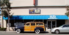 Looks to be a 46-48 Ford Woody Wagon parked at the curb in front of the Balboa Market shot while driving on Balboa Blvd on the Balboa Peninsula Newport Beach California (moondoggie71) Tags: ocean street black ford 1948 beach car del wagon awning bay coast mar store whitewalls surf pacific wide culture woody surfing corona newport storefront balboa peninsula cruiser blvd whitewall 1947 onthestreet 1946 nostaligia widewhitewalls